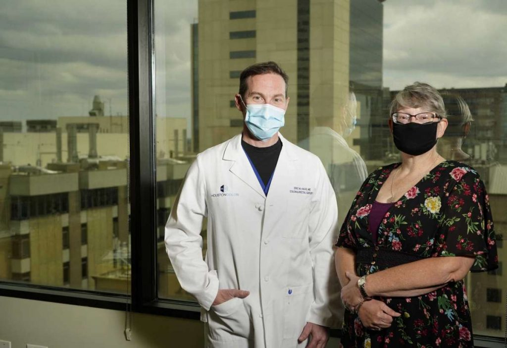 Dr.Eric Haas and Yvonne Vives wearing Mask logo